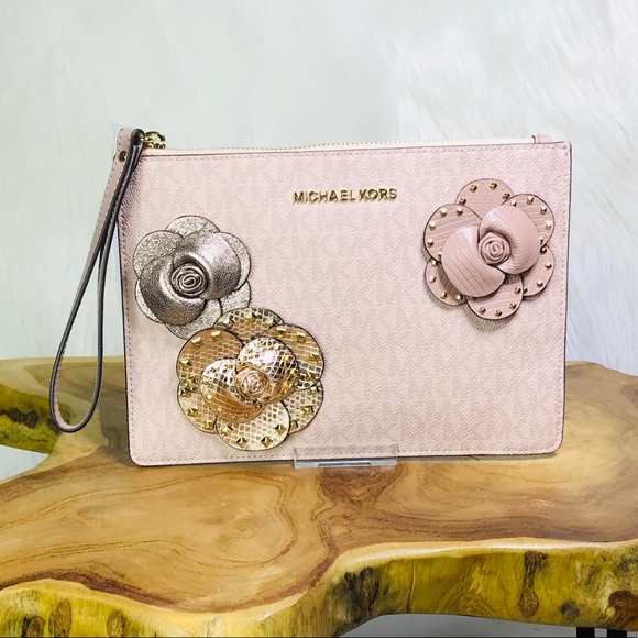 bcc469df4683 Michael Kors Bags | Jet Set Travel Studded Floral Clutch | Poshmark